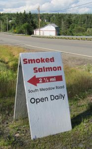 photo of sign reading _fresh crabmeat, live lobster, cherrystones, mussels, clams