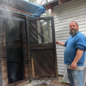 a man standing at the door of a smoker.