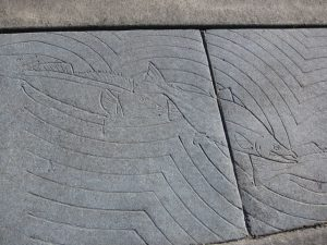 Fish design in sidewalk in Valdez