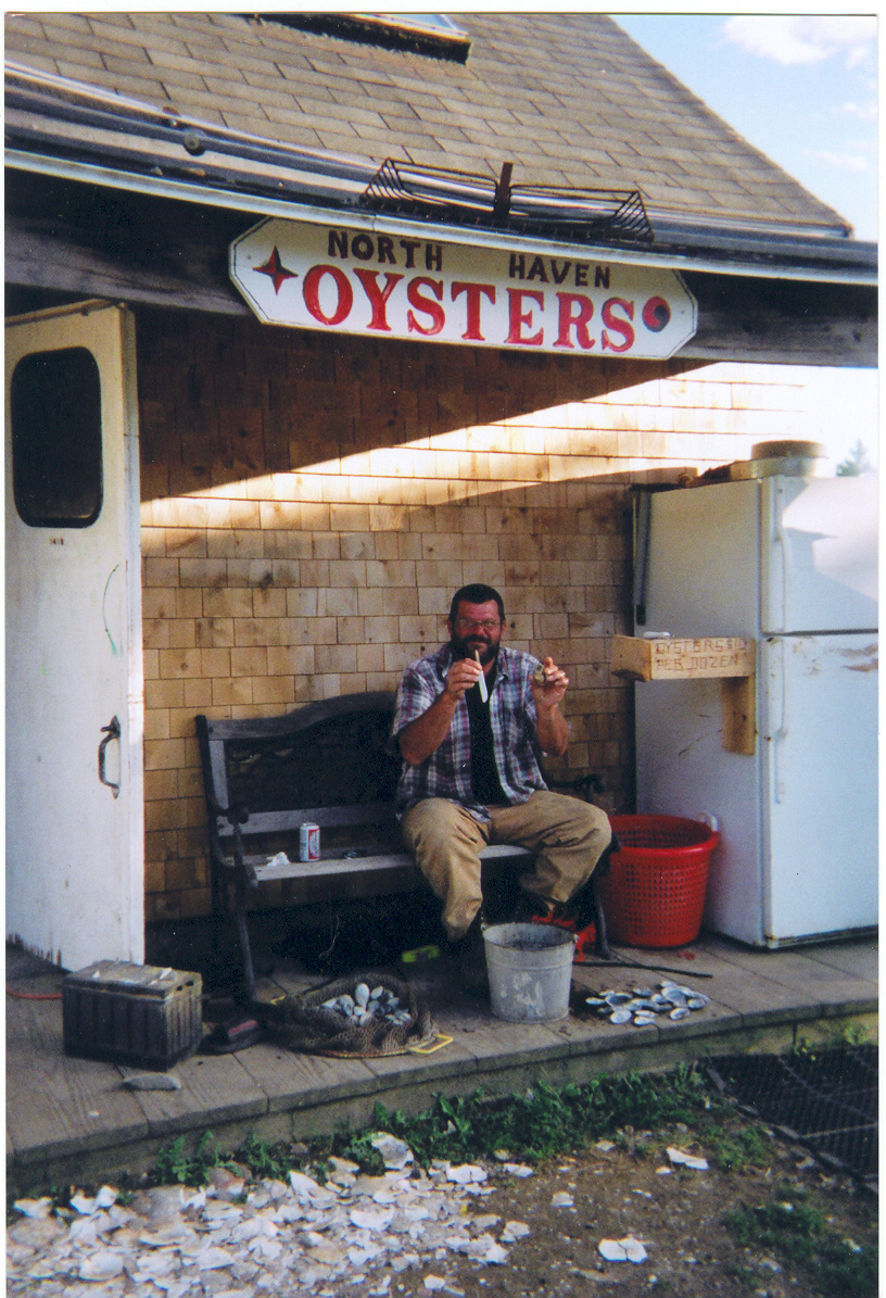 photo of a customer in front of the North Haven Oyster Company storefront