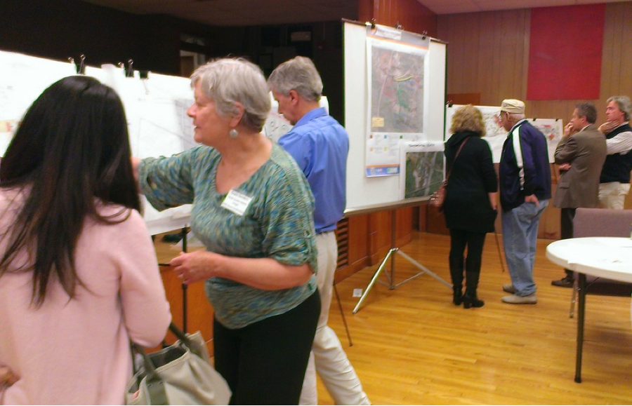 Designs are posted by the charrette team, as community members start to filter in for the presentations to reveal the designs.