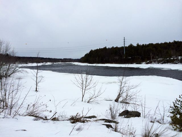 snow and open water on the Penobscot River at site of former dam