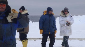 Alaska Sea Grant agent Paula Cullenberg with Native Alaskan hunters on North Slope G. Sheffield photo.