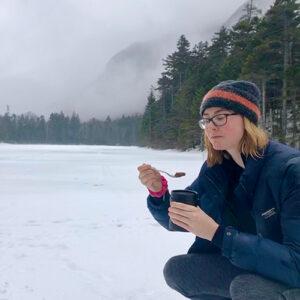 Lucie Nolden crouching on snowy ground