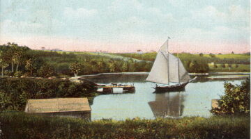 old-fashioned postcard of a boat in a cove