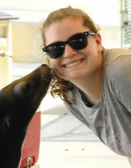 Alesha Gregoire with a seal