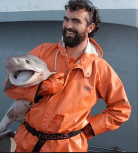 Nathan Willse holding a shark