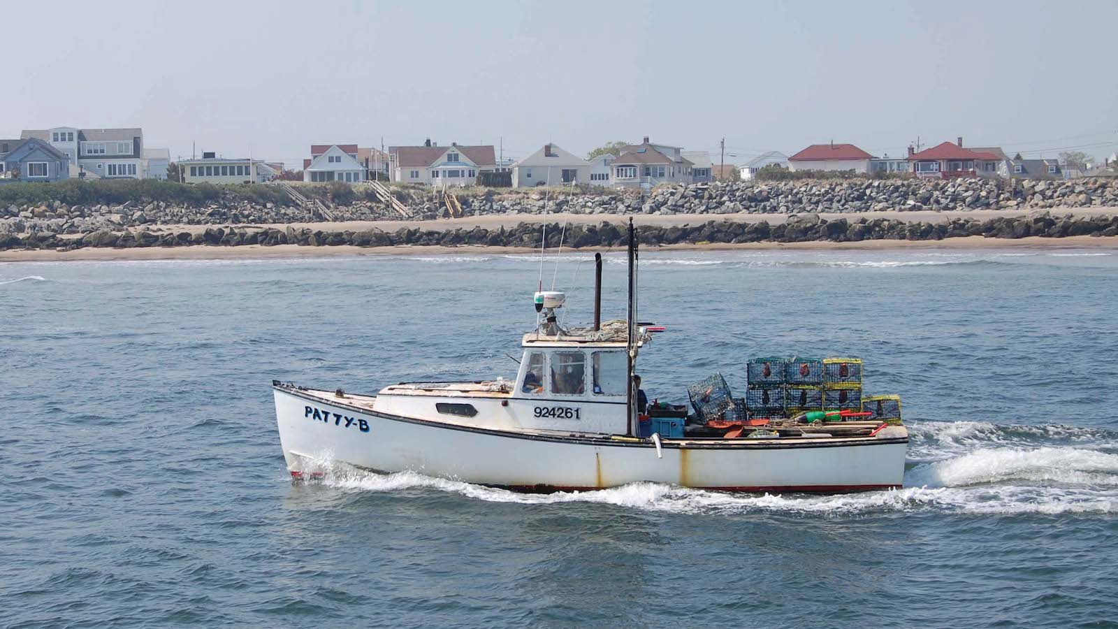 Lobster vessel with traps on the back