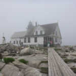 House in fog on granite ledge, foggy background